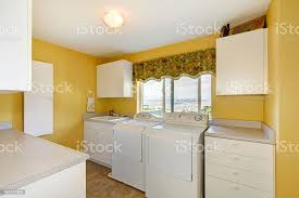 yellow kitchen walls white cabinets laundry room with white cabinets and yellow walls stock photo image now