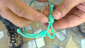 simple rope bracelet images Sawyer making rope bracelet jpg
