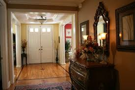 Foyer Interior Design With Brown Drawer Feat Planters And Table - Foyer interior design ideas