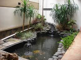 minimalist garden design with koi fish pond adorned natural stone