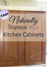 clean kitchen cabinets wood how to clean grease from kitchen cabinet doors white vinegar