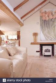 cream sofa in modern cottage living room extension with large