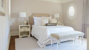 white and beige bedroom with lucite bench transitional bedroom