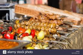 bounty of cooked meats and vegetables arranged neatly on metal