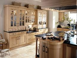 a luxuriously brown colored kitchen with complete ornaments and