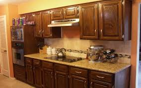 kraftmaid white kitchen cabinets dark brown wooden kitchen cabinet with marble countertop also
