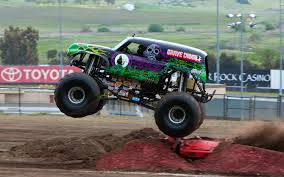 picture of grave digger monster truck image grave digger drivers side short jump jpg monster trucks