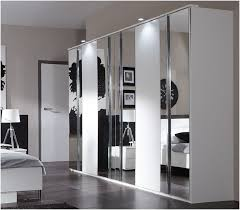 White Wardrobe Cabinet Furniture Awesome White Wardrobe Design With Mirrored Glass And