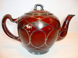 beautiful porcelain reddish brown teapot with mesh sterling silver
