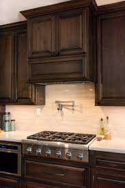 black stain on kitchen cabinets traditional mediterranean custom kitchen cabinets in paso
