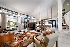 an open living area design with modern sofa and armchairs also a