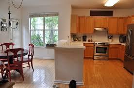 builder grade remodeling a builder grade kitchen wood floors overlay granite