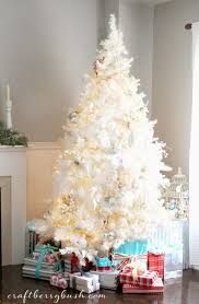 blue tree lights with white cord skirt