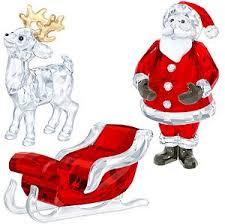santa sleigh and reindeer swarovski santa sleigh and reindeer set save swarovski