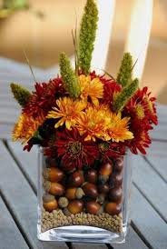 fall flower arrangements acorns line a vase fall flower arrangements and thanksgiving