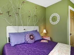 outstanding green wall painting and purple comforter platform bed