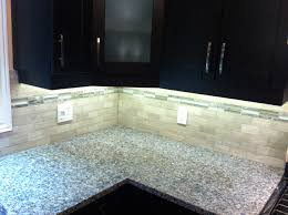 2x4 escarpment marble with a glass and marble mix mosaic