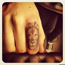 lion finger tattoos cara delevingne debuts new lion tattoo on her finger pictures