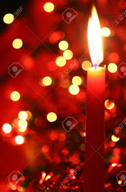red christmas candle with colorful lights and tinsel in