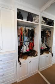 minimalist walk in closet with wooden closet storage organizer