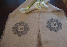 diy monogrammed burlap table runner baby shower on brown wooden