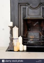 close up of black cast iron fireplace with group of candles on the