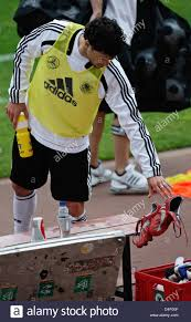 buy football boots germany german national player michael ballack throws a pair of football