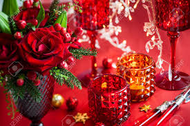christmas table decoration with flowers and candles stock photo