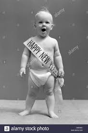 baby new year sash 1940s baby standing in yawning wearing happy new year sash