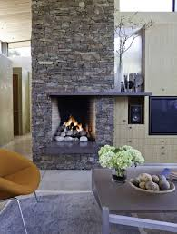 family room with stone fireplace in modern and rustic style beach
