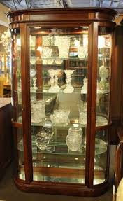 glass shelves for china cabinet ashley china cabinet in a dark finish with lighted glass door hutch