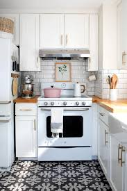 what s the best thing to clean kitchen cabinets with how to clean a stove top including tough cooked on spills