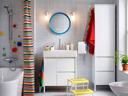 bathroom furniture bathroom ideas at ikea ireland a large white bathroom with a high cabinet and a washstand combined with colourful shower curtain