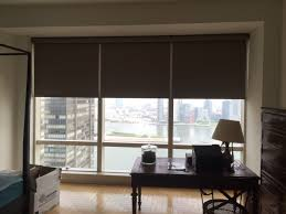 motorized roller shades by ny city blinds offer privacy at the