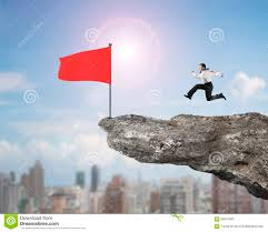 Red Flag Day Man Running For Red Flag On Cliff With City View Stock Photo