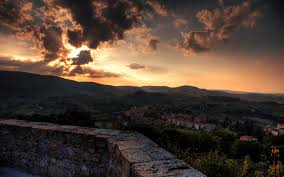 toscana italy tuscany sunset town sky clouds fence buildings