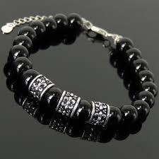 black onyx charm bracelet images Saints fleur de lis emblem charm bracelet black onyx healing 8mm jpg