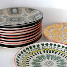 painted stoneware plates by the forest co