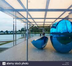 glass pavilion with jeff koons sculpture island pavilion and