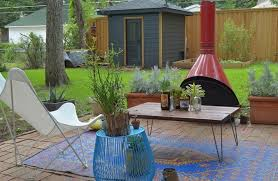 Outdoor Metal Fireplaces - outdoor metal sofa frame with brown outdoor rug also potted