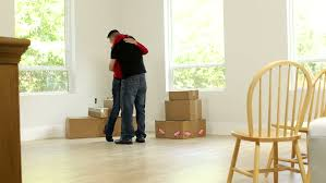 Chair Boxes Moving Couple Moving Boxes Into New Home Stock Footage 4551005