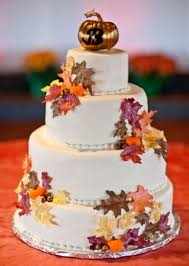 autumn theme 4 tier round wedding cake with fall foliage and
