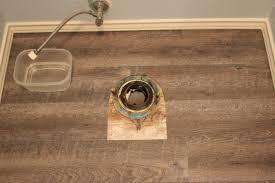 peel and stick vinyl plank flooring diy sprinkled with sawdust