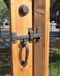 a beautiful gate latch drop bar on a custom gate fence www