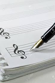 paper writing music blank sheet music with fountain pen stock photo picture and blank sheet music with fountain pen stock photo 11744773