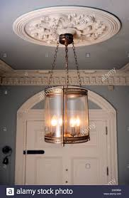 unusual light fittings stock photos unusual light fittings stock an unusual brass lantern hanging from an ornate plaster ceiling rose in a georgian townhouse in