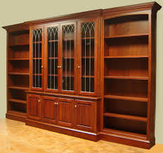 furniture brown stained wooden floor to ceiling bookshelf with