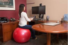Sitting On A Medicine Ball At Desk How To Be More Active During Your Workday