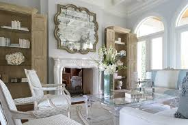 dining table in front of fireplace wall mirrors as living room design among mirror above fireplace
