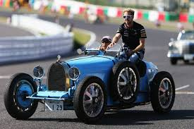 old bugatti f1 race car versus supercar